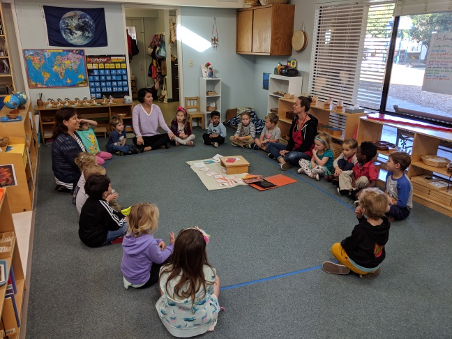 Montessori Kindergarten students sitting in a circle